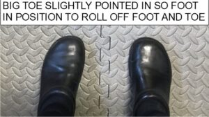 photo of feet with big toe lightly pointed in. The side of the foot now pointing straight forward